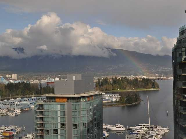 """ATTENTION INVESTORS- Million dollar N/E COAL HARBOUR, OCEAN, MARINA MOUNTAIN AND STANLEY PARK VIEWS from this 2 bedroom and den/office, 968 sqft, show room condition condo at the Architectural landmark, the QUBE. Beautiful hardwood flooring , over height 9'6"""" ceilings, stainless steel appliances, open plan kitchen with island, black granite countertops, kitchen aid appliances, spa inspired bathrooms. Best floor plan and layout in the building. 1 parking, bike locker, party room and 24 hr concierge. Seawall, Stanley Park, Robson, Convention Center, Sky train, restaurants and cafes all outside your door. Fantastic furnished rental income, vacation home or just live in full time."""