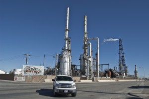 A constant stream of heavy truck traffic rumbles past HollyFrontier's Navajo Refinery in Artesia. The facility processes up to 100,000 barrels per day of crude oil, most of it pumped from New Mexico and Texas. Photo: Margaret Wright