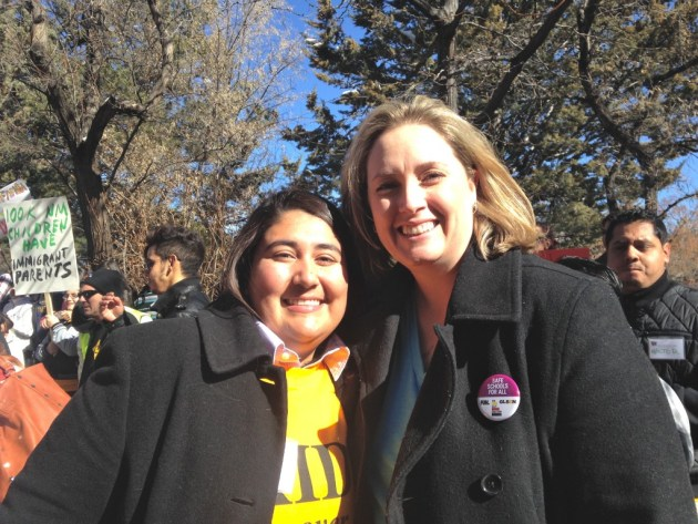 "Amber Royster (right), director of Equality New Mexico, appeared at the rally with the group's Southern New Mexico Field Coordinator, Myra Llerenas (left). Said Royster, ""We've had a law that's worked for ten years, so why the heck are we wasting a bunch of time, energy and money to repeal something that already works and is already being modeled by other states at this point? We already know as LGBT people that separate is not equal, so this idea of the two-tiered driver's license flies in the face of what equality actually is."""