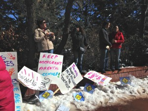 Photo of rally against repealing law that allow undocumented immigrants to earn driver's licenses from Feb. 2, 2015.