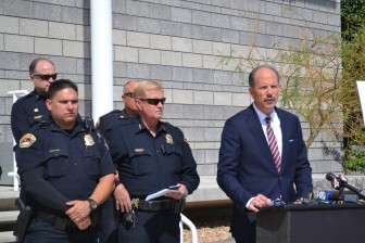 Albuquerque mayor Richard Berry with Albuquerque Police Department Chief Gorden Eden and others. Photo Credit: Andy Lyman