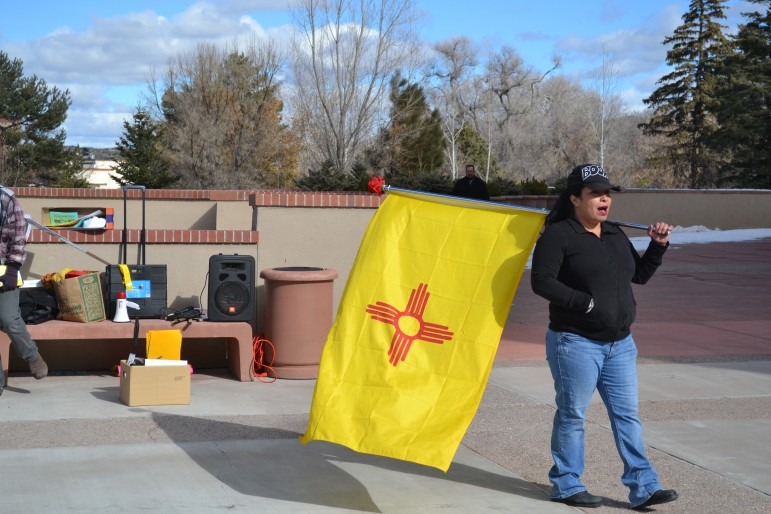 Members of Occupy New Mexico gather outside the state capitol building