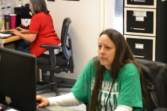Cindy Maldonado, right, helps coordinate operations at Albuquerque High School's health clinic.