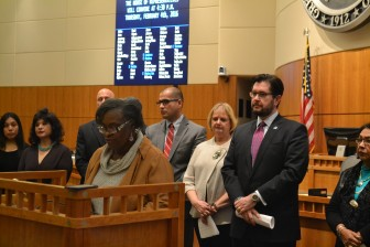Rep. Sheryl Williams Stapleton speaks while Minority LEader Brian Egolf (r) and other Democrats look on.
