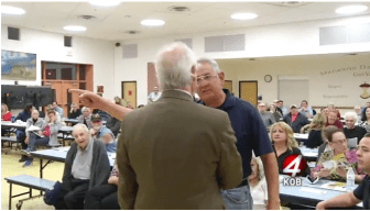 A man yelling at Albuquerque City Councilor Isaac Benton during a meeting on ART. Screenshot from KOB-TV.