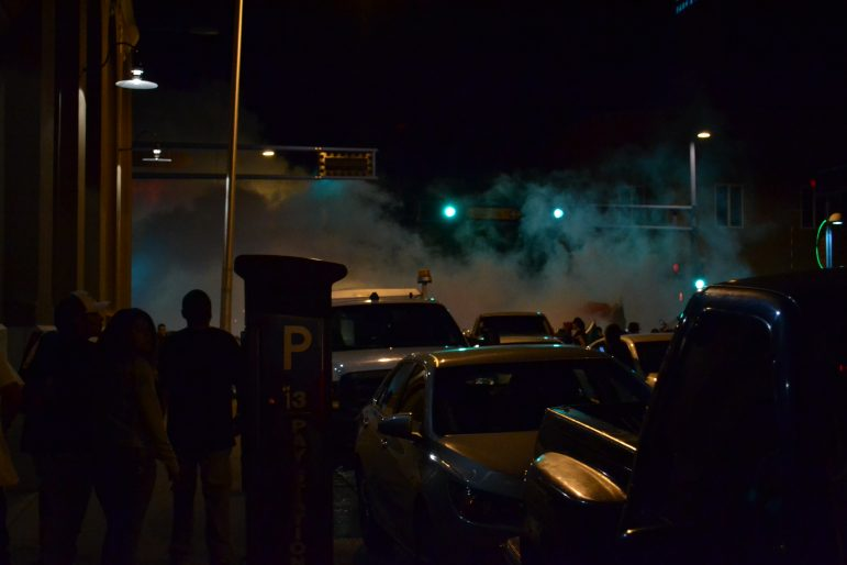 Smoke fills the air after a Donald Trump rally as protesters clash with police.