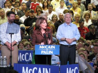 Sarah Palin speaking at a rally at the Albuquerque Convention Center in September, 2008, while John McCain looks on.