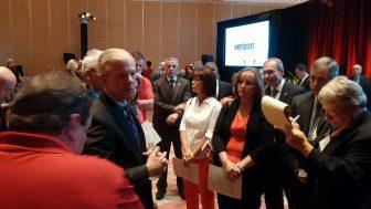 Striking Verizon employees confront CEO Lowell McAdam, center.