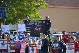 Protesters outside a Verizon shareholders meeting in Albuquerque