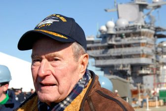 Former President George H. W. Bush looks down the flight deck of the Precommissioning Unit (PCU) George H.W. Bush (CVN 77) during the ship's catapult testing ceremony. Via U.S. Navy