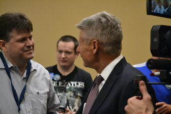 Gary Johnson speaking to a supporter