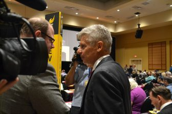 Gary Johnson speaks with a supporter during the election at the 2016 Libertarian National Convention