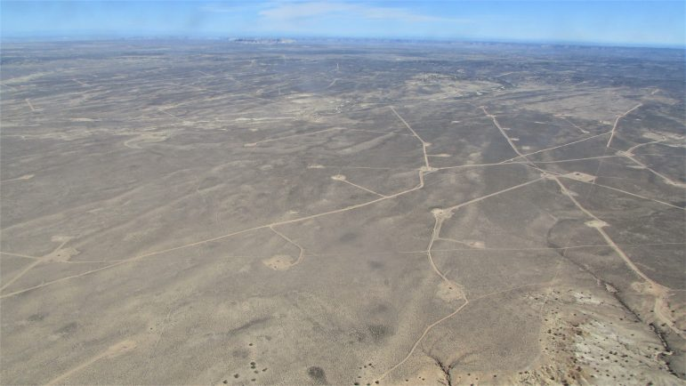 Well pads and their associated roads are easily visible from the sky.