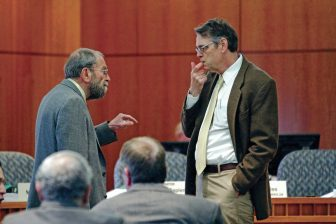Jim Peach, left, of New Mexico State University's Department of Economics, Applied Statistics and International Business, and Jeff Mitchell, with the Bureau of Business and Economic Research at The University of New Mexico, talk before testifying before the Senate Finance Committee at the state Capitol on Tuesday, January 24, 2017.