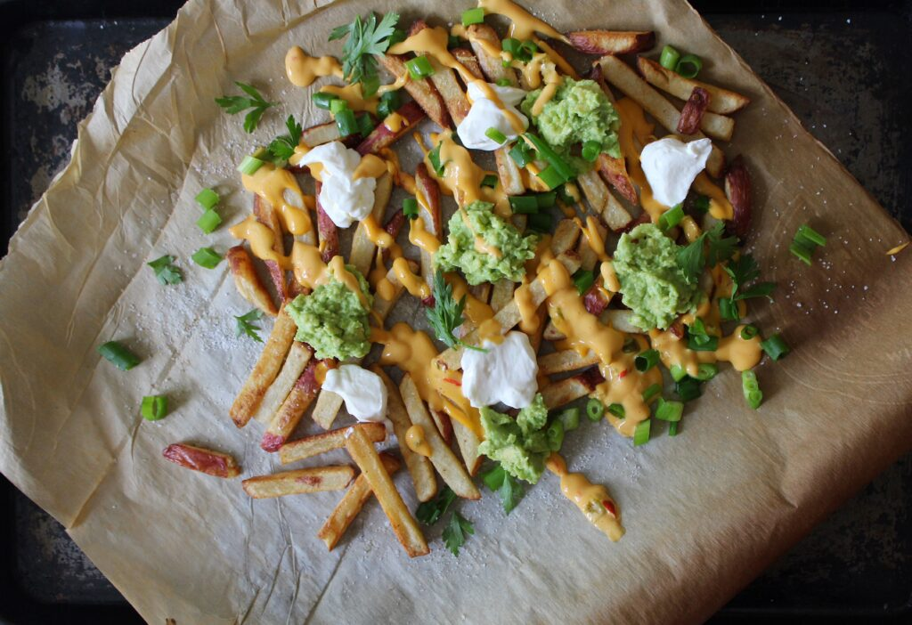 Baked Fries with Salsa Queso and Guacomole