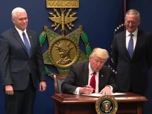 """President Donald Trump signs Executive Order 13796 on Jan. 27. The order, commonly referred to as an """"immigration ban"""" bars people from seven countries to enter the United States. PHOTO CREDIT: PUBLIC DOMAIN"""