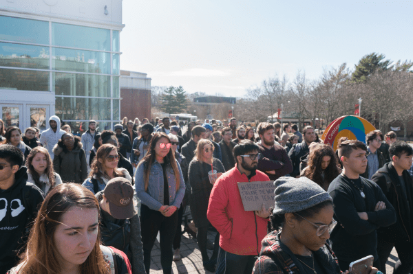 Students spoke in front of a crowd outside the Student Activities Center. GARY GHAYRAT/THE STATESMAN