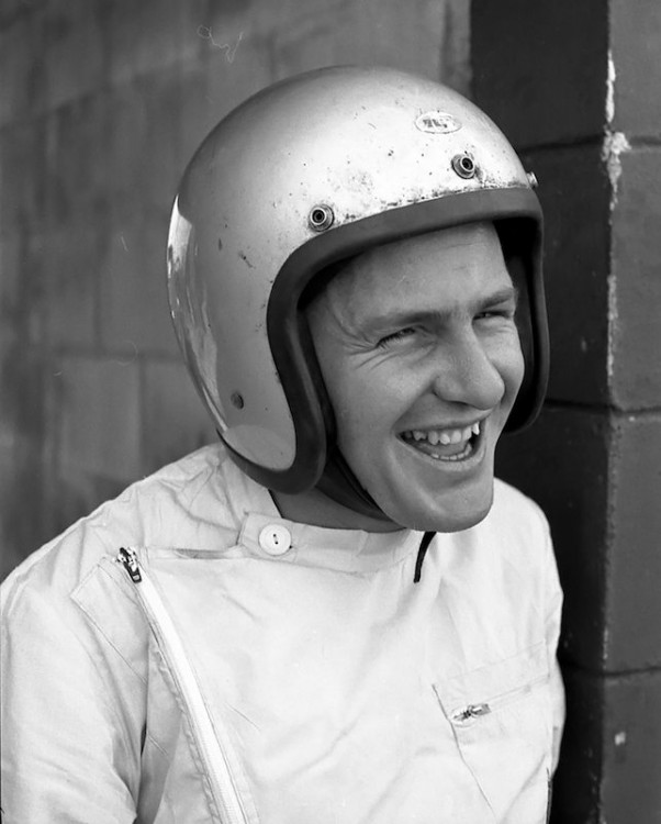 Bruce McLaren laughing it up in the pits
