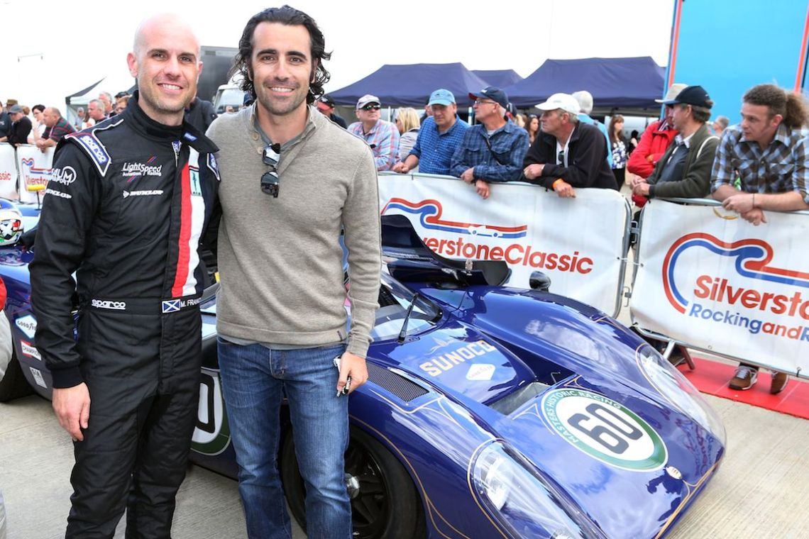 Marino Franchitti and Dario Franchitti share a moment at Silverstone Classic 2015