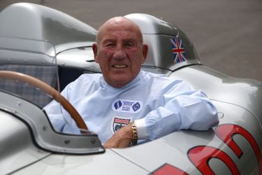 Sir Stirling Moss at the wheel of the 300 SLR with starting number 722