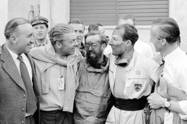 Mille Miglia (Brescia/Italy), May 1, 1955. Celebrating the victory of Stirling Moss and Denis Jenkinson (from left): senior engineer Ludwig Kraus, senior engineer Rudolf Uhlenhaut, Denis Jenkinson, Stirling Moss and Dr. Hans Scherenberg.