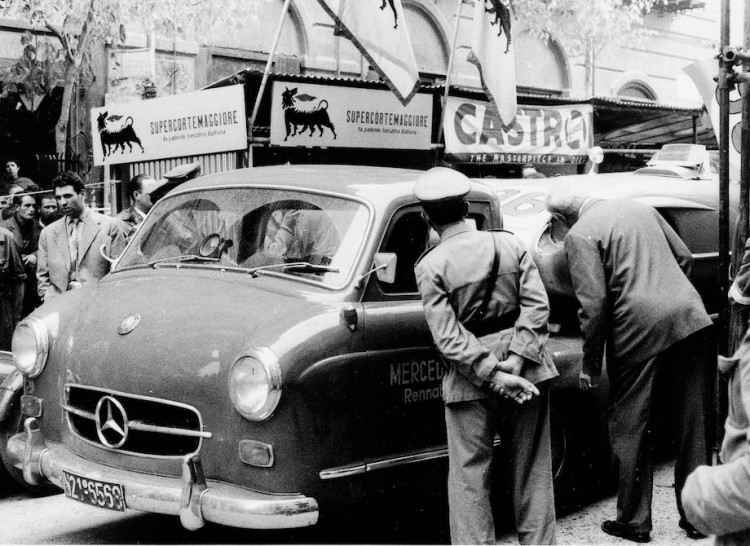 Mercedes-Benz high-speed transporter with a 300 SLR (W 196 S) racing car on the loading area.