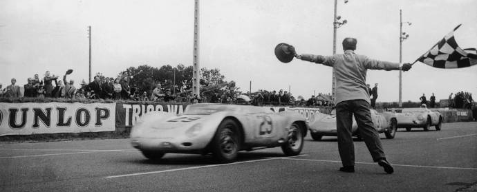 Jean Behra crossing the Le Mans finish line in 1958 in the 718 RSK