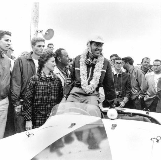 Carroll Shelby celebrates 1st Overall victory in 0510 M at the 1956 Del Monte Trophy in Pebble Beach as Jim Hall (second from left) looks on at the car he would go on to own for the next six decades (Courtesy of Jim Hall)