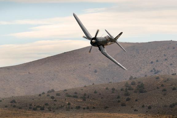 Corsair F4U-4 down low across the valley towards pylon six