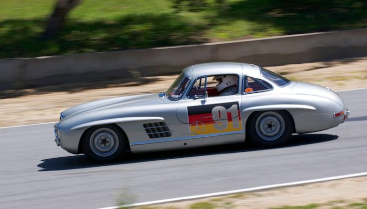 1955 Mercedes 300SL Gullwing dives down the hill driven by Alex Curtis.