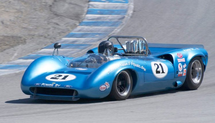 Out of the Corkscrew comes Nick Colonna in his 1967 Lola T70 Spyder.