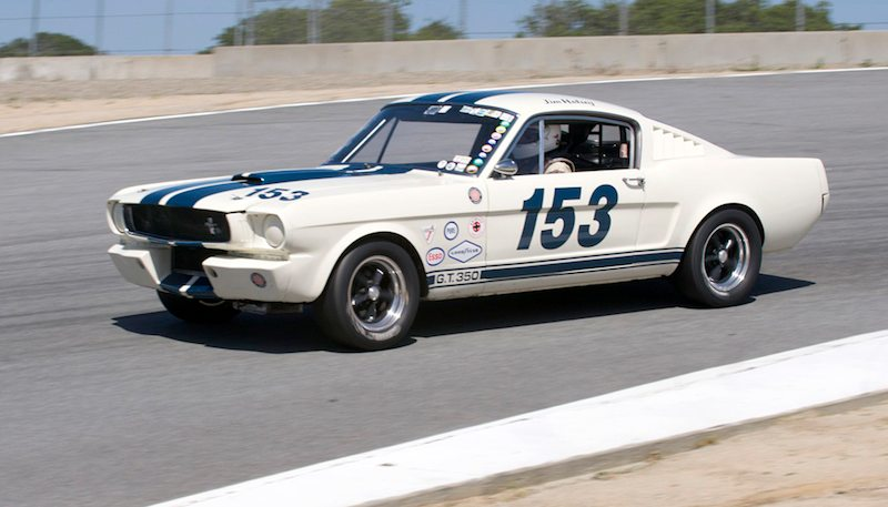 Top of the hill before the Corkscrew is the 1965 Shelby GT350 of Jim Halsey.