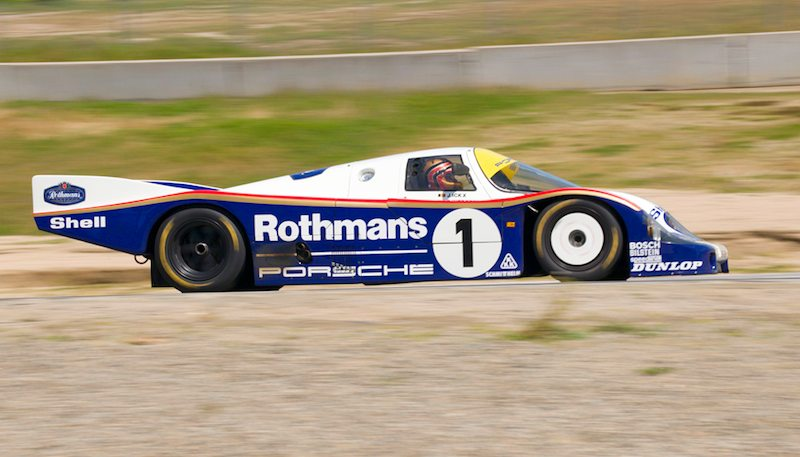 Up the hill to turn six, Ranson Webster in his Rothmans Porsche 956.