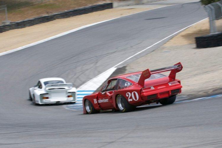 Ken Epsman's 1976 Dekon Monza chases Bruce Canepa's Porsche 935 down the Corkscrew.