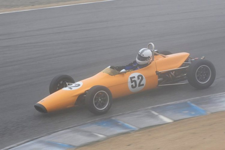 Carl Moore's 1969 Titan MK IV dives into turn 8 during