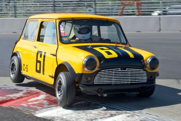 Don Racine two wheels his 1961 Austin Mini Cooper through turn 1.