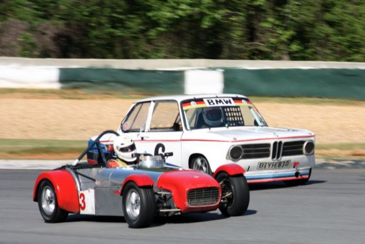 Bill Bartlett, 62 Lotus Super 7 dueling with Andre Herke, 68 BMW 2002.