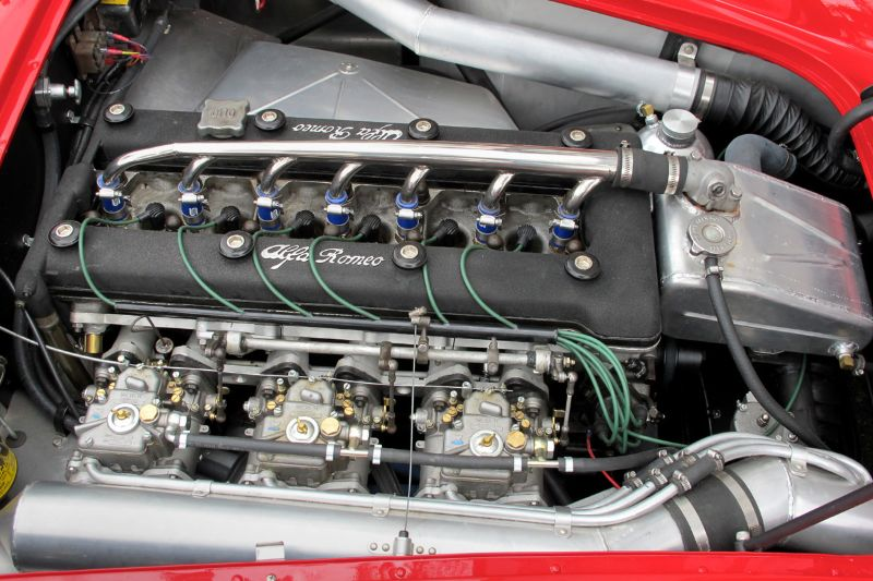 Hood up, the engine in Al Corts' 1964 Alfa Romeo 2600 shows off its three twin-chock Weber carburetors.