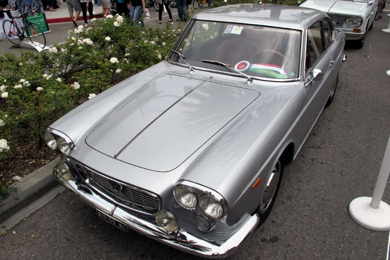 Straightforward in appearance and use, this is Adan Figueroa's 1966 Lancia Flavia Coupe next to Rodeo Drive's roses.