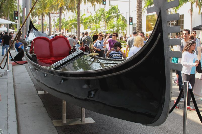 Enamored of Italian beauty, David Sydorick bought this authentic 38-ft Venetian gondola as a birthday present for his wife, Ginny, and they hauled it to Rodeo Drive for the show.