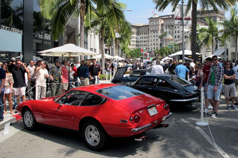 Looking south past Richard Cole's 1972 Ferrari Daytona 365 GTB/4 on Rodeo Drive toward the Beverly Wilshire Hotel.  The black fastback is a 1963 Apollo GT with Italian-built body over American running gear and Buick engine.