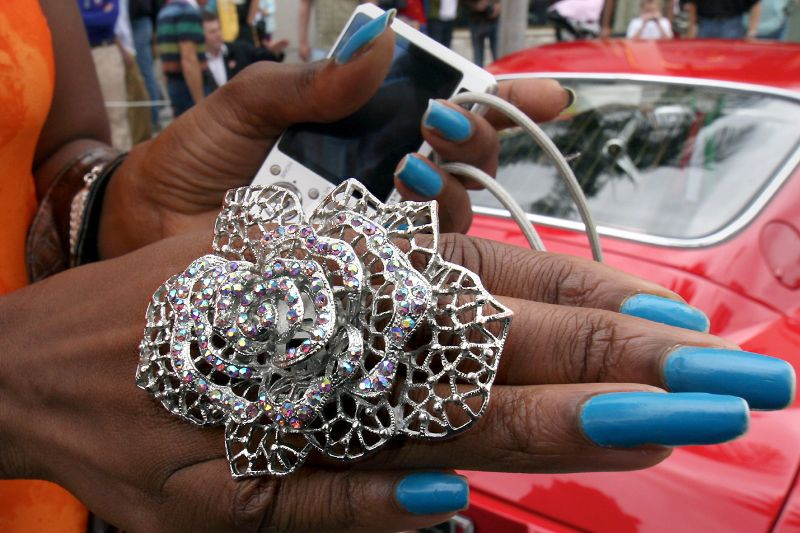 This Rodeo Drive Concours attendee loves her Big Ring and Mini Camera.