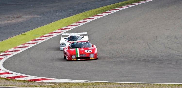Ferrari 512 BB LM followed by Porsche 962