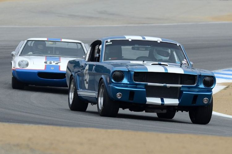 Bob Pais in his 1965 Ford Mustang leads a Lotus 47.