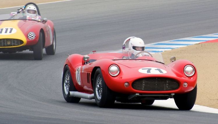 2011 Pre-Reunion, Saturday. As the fog lifts Greg Myer's 1958 Devin SS leads Ole Anderson's Byers Volvo Special in turn five.