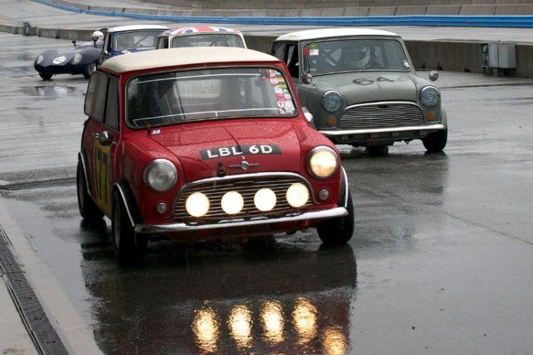 Dennis Racine's 1966 Mini Cooper S, Najeeb Khan's 1966 Mini Cooper S lead out Group 2 Saturday morning.