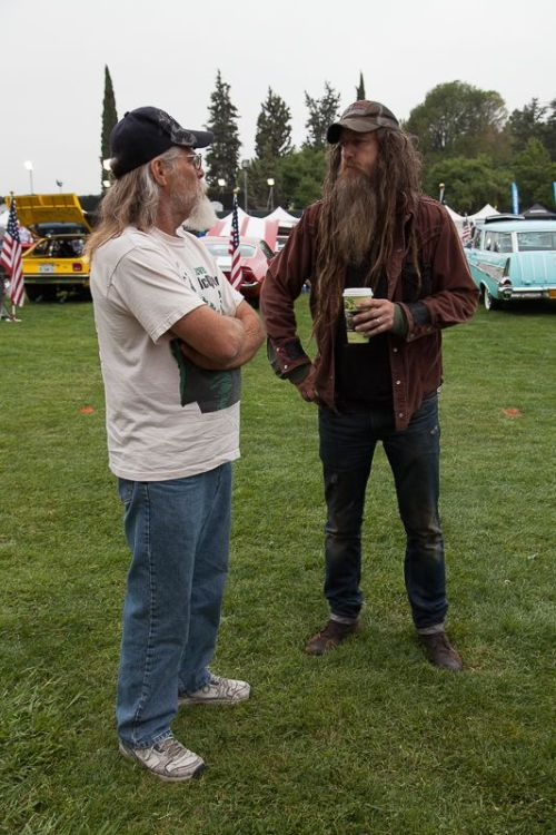Urban Outlaw and Porschephile, Magnus Walker (right), talks with a show attendee.