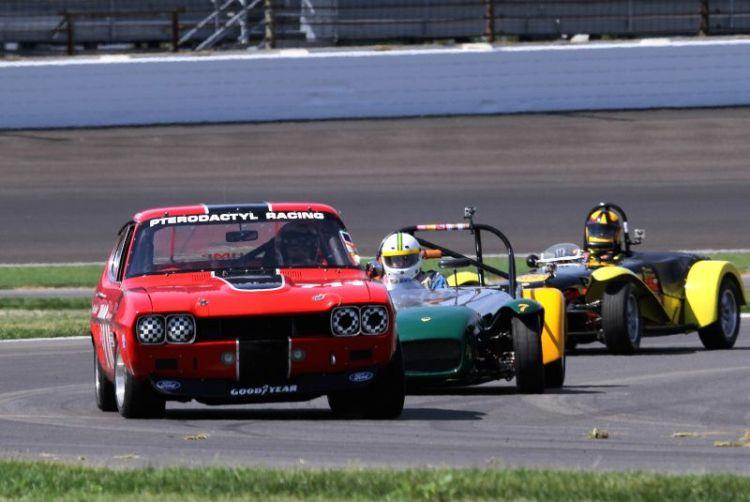 Ira Schoen, 71 Ford Capri ahead of two Lotus Sevens.