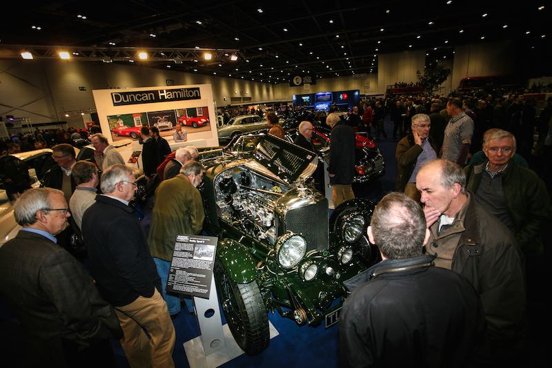 Visitors at the London Classic Car Show