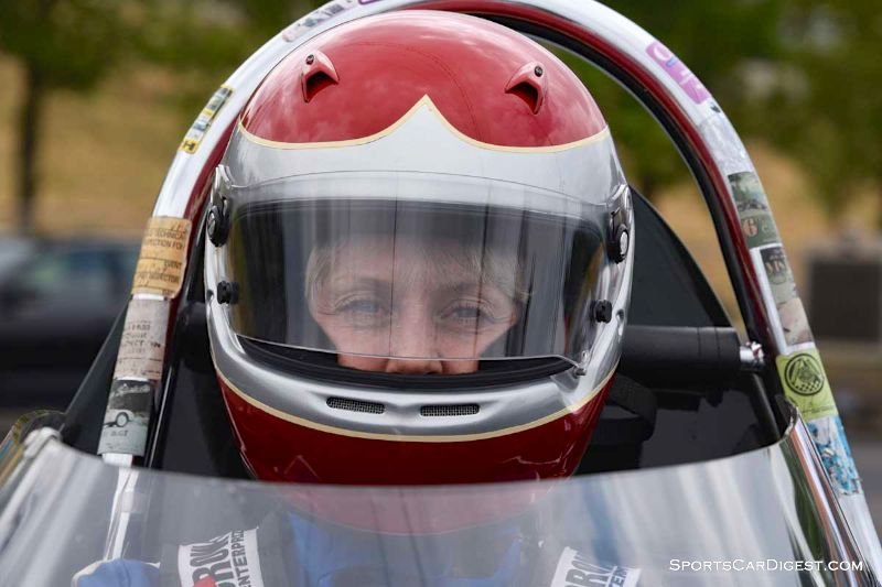 Jacqulyn Mincheff inside the 1956 Lotus 11 at Portland Historic Races 2015